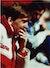 Kenny Dalglish sitter på benken under en kamp i 1989.